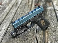 Glock 19 with Guillotine cut Tread Side Serrations lasered honeycomb and spartan helmet