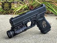 Glock 19 with Guillotine cut Tread Side Serrations lasered honeycomb and spartan helmet in black